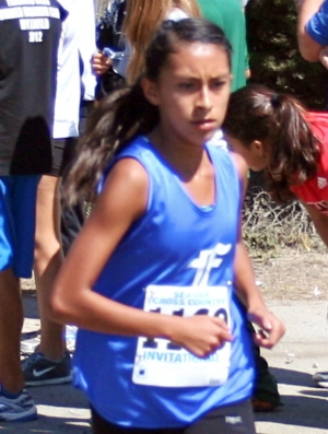 Irma Torres placed 7th in her race with a time of 18:57 becoming Fillmore High School's fastest freshman on the Seaside Invitational course.
