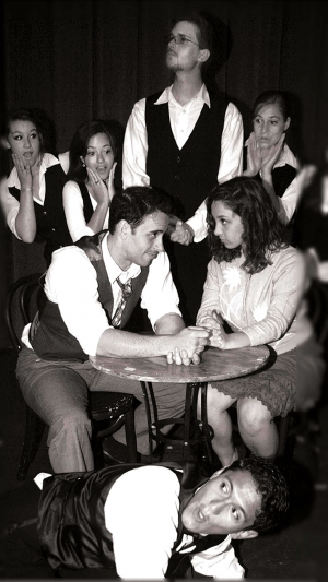 Georg (Geoffrey Helms) and Amalia (Danielle Protugal), seated, share an uncomfortable moment with the busboys and waiter at the Cafe' Imperial in SHE LOVES ME.