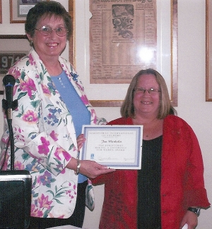 Betty Carpenter presents Jan Marholin, Principal of San Cayetano Elementary School, with the Soroptimist Making a Difference for Women Award for the dedication, devotion and significant impact she has made on the lives of students, school and community.
