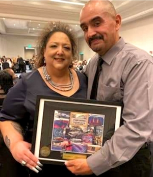 (left) Sonia Chessani with Good Times Car Club Founder Paul Sanchez at the National Lowrider Hall of Fame induction
