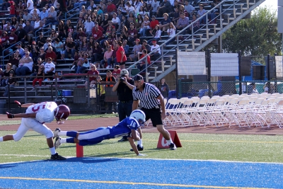 Saul Santa Rosa dives into the end zone for a touchdown