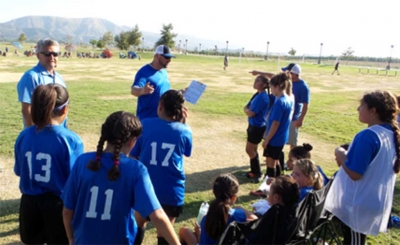 California United U-11 Coaches going over the adjustments the team needs to make before they begin the second half of the game against Valley United. Photo Courtesy of Ofelia Tello.