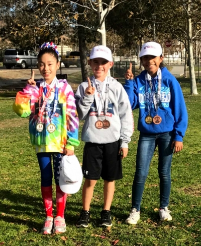 (l-r) Paola Estrada, Ayden Marquez and Niza Lauerano who were named All American Athletes at the USATF Jr. Olympic Cross Country National Championships. Photo Courtesy Erika Arana.