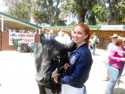Brittany Gurrola with her steer Oreo.