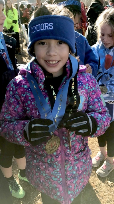 Seven year old Paola Estrada received medals for placing 9th out of 120 runners in the 8 & under division in Alabama.
