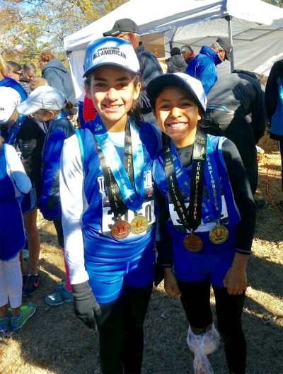Lindsey Ramirez placed 14th and teammate Niza Laureano placed 15th out of 341 runners in the 9 & 10 year old division