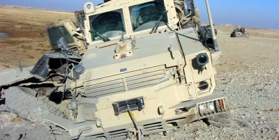 Above and below, a military truck damaged by a 152 mm artillary shell in Afghanistan.