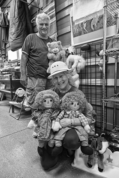 Terrie Metzler accepting a donation of toys by Milan Boyanich of A Street Self-Storage. The toys destined for the Shriner's Hospital for Children, Los Angeles.