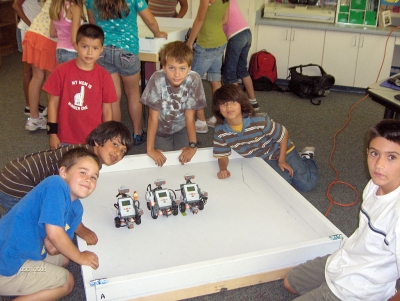 Mrs. Walker's 4th grade students working with robotics.