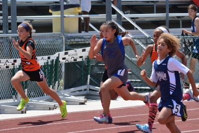 Emily Briseno (center) will continue to our Co Conference Championships in both 100 meter and 400 meter dashes.