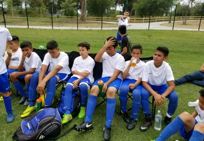 California United Boys U-13 resting and preparing for the second half of the game to begin against the Oxnard Pal. Photo Courtesy of Javi Alcaraz.