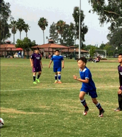 California United U-12 player starting his run on a free kick versus VC Galaxy. Picture by Brenda Melendez.