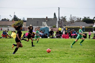 California United Forwards Marlene Gonzales and Jadon Rodriguez pressure the Nacional defense with their great speed and ball skills. Final score 2 – 1 California United. Photo courtesy Evelia Hernandez.