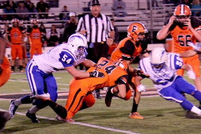 Varsity #54 Chad Petuoglu making a tackle