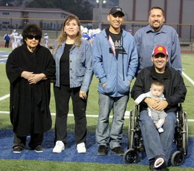 J.V. Cheerleaders escorted a few of the Hall of Fame recipients on the field. Adolf Valquez is wearing his Lettermans Jacket. Right is Jim Reisgo.