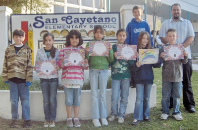 San Cayetano students show off their Personal Success Award certificates.