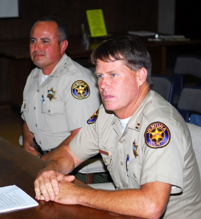 Left, Deputy Leo Vazquez with Captain Tim Hagel (right) review the benefits of the SRO during Tuesday night's meeting.