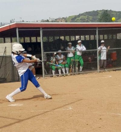 Freshman Jazmine Zavala knocking her first high school homerun out of the park.