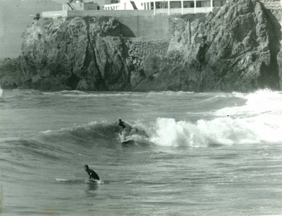 Surfers underneath the Cliff House, San Francisco. Photo credit: Fred Windisch