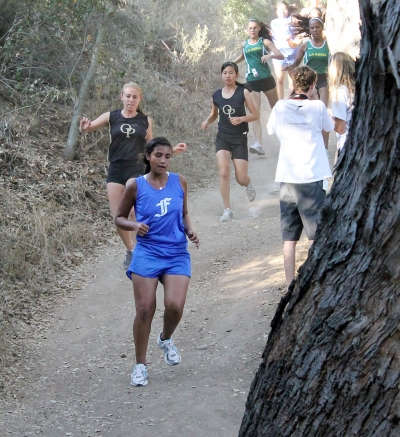 Justine DeLa Rosa competes against Oak Park and La Reina during league last week.