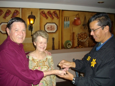 Detective Marty Luna giving the ring to Richard and Donna.