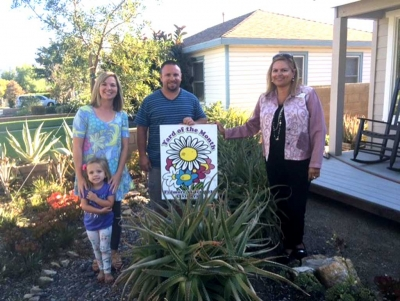September Yard of the Month Winner's (l-r) Brynn, Megan, Eli Hernandez and Ari Larson.