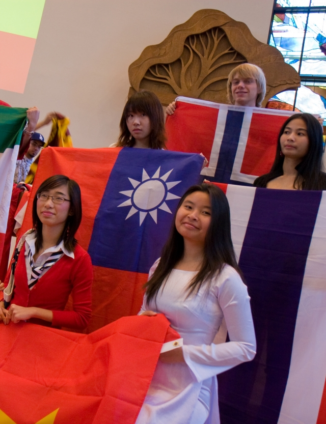 Students with their flags at the International Chapel Service. Photo credit: Brian Stethem