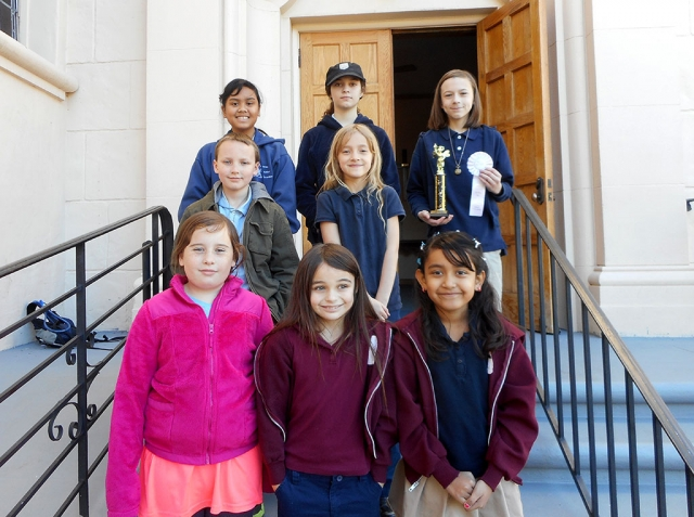 (l-r) (front row) Yetta Hurd (4th grade), Anna Walls (3rd grade), Viviana Ramirez (1st grade); (second row) Gabriel Lidikay (6th grade), Brenna Larson (2nd grade); (third row) ImaJoyZerrudo (5th grade), Ashley McKnight (7th grade), Sebastian Lidikay (8th grade).