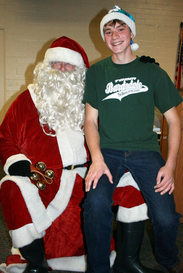 Bardsdale 4H President Timmy Klittich enjoyed visiting with Santa at the club Christmas party.