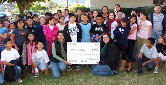 Pictured (l-r) are teacher Mrs. Delia Sliva and teacher Miss Claudia Cornejo and the 5th graders from Piru Elementary with a $500 check from the Ventura County Sheriffs for Friends of Fillmore Outdoor Education and Leadership Training. Ten more sponsors of $250 each are needed to send the entire class.