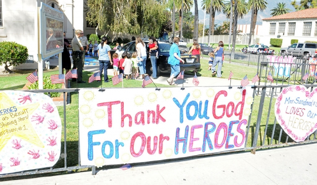 The children of Fillmore Christian Academy remembered the victims of 9/11 with banners and flags last Monday. Fillmore firefighters and sheriffs joined the memorial.