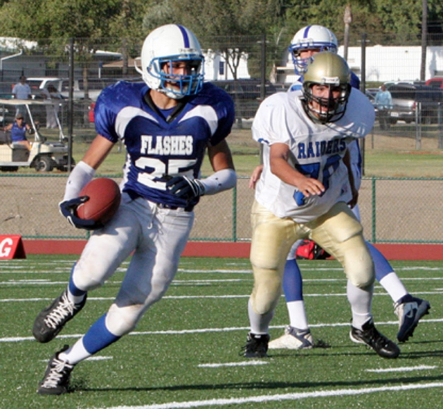 Austin Davis #25 pictured above, scored 3 touchdowns-picking up a fumble the first play of the game & running it in for a touchdown--he also ran one in from the backfield & caught one from Corey Cole, about a 40 yd pass. Johnny Golson threw a touchdown pass to Ben Fernandez, about a 35 yd pass. Jordan Davis had an interception. Ty Casey ran the ball well with 10 carries for about 100 yds. Joel Amaro kicked 3 field goals. On defense Anthony Edwards, Sam Orozco, Angel Beccera, & Johnny Golson played well. Fillmore beat Channel Islands 27-21.