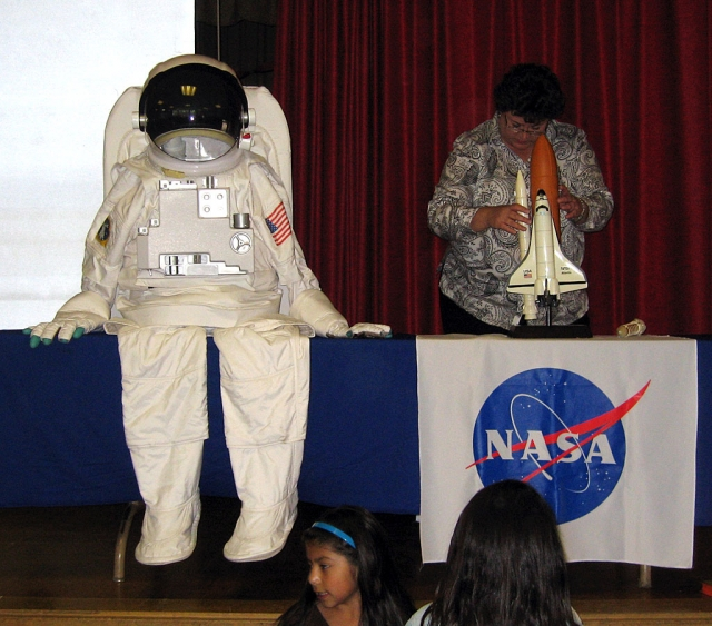 Beth White from NASA showcases an astronaut suit.