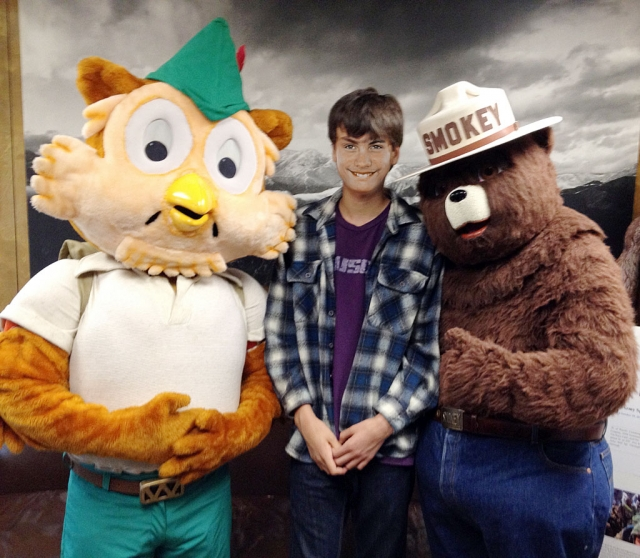 "Diego Rodrigues with Woodsy Owl and Smokey the Bear at the ""Get the Green"" video and photo competition awards presentation."