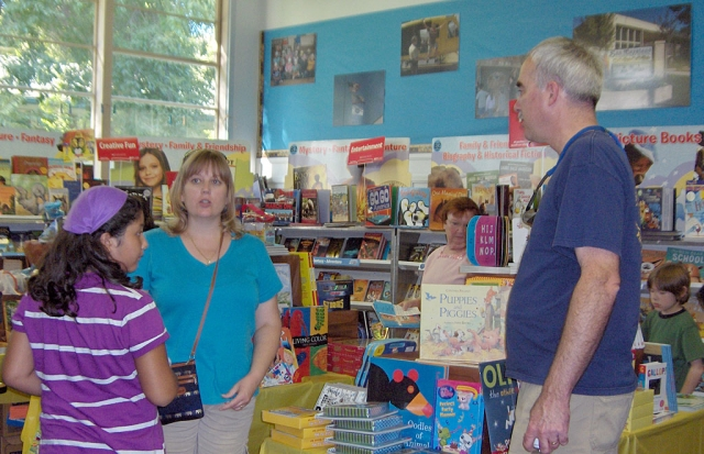 Mr. and Mrs. Chandler visiting the Book Fair.