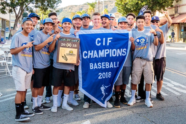 (above) The 2018 CIF Baseball Champions smile for a photo holding their banner and plaque. Fillmore High School held their Parade of Champions on Friday, July 6th at 6pm in downtown Fillmore to celebrate the CIF championships won by the baseball team and swimmer Katrionna Furness. People were able to hear the players and coaches speak, meet the team, and celebrate our champions. The players autographed complimentary 8x10 photos for the children. They had food trucks, vendors and entertainment for everyone to enjoy. Food Vendors: Fernandos Churros,  Amecis Pizza, Central Station Street Tacos, Raspado House, Nothing Bundt Cakes, Oh my gosh hot dogs. Parade line up: Police Chief Eric Tennessen, Cross Country, Heritage Valley Blazers, Fillmore Raiders, Girls Softball, Little League, Voltage Cheer, AYSO, Fillmore Bears, Girls Soccer CIF Champions, Kat Furness Swim CIF Champion, 1988 Baseball CIF Champions, and the 2018 Boys Baseball CIF Champions.Entertainment: Fillmore High School Ballet Folklorico, DJ Danny Ibarra. Photos courtesy Bob Crum.