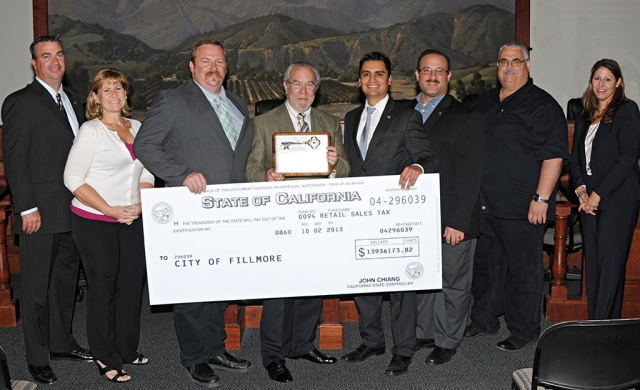 From the left: City Manager David Rowlands, Councilmember Diane McCall, Mayor Rick Neal, Mike Sedell, Mayor Pro-tem Manuel Minjares, Councilmembers Douglas Tucker and Steve Conaway, and City Attorney Tiffany Israel. This is a day for the residents of Fillmore to rejoice and remember. The $14 million dollar check presented at Tuesday's regular council meeting represents a strong new start for the City of Fillmore. It's been a long time coming. The team shown in the photo above, and our hard-working city staff, are responsible for this financial victory. Special thanks is also due to Mike Sedell, former City Manager of Simi Valley. He has used his unique, extensive experience with tireless voluntary efforts to get Fillmore back on track at many levels. No one deserves the key to the city more than Mike Sedell. Congratulations to the whole team.