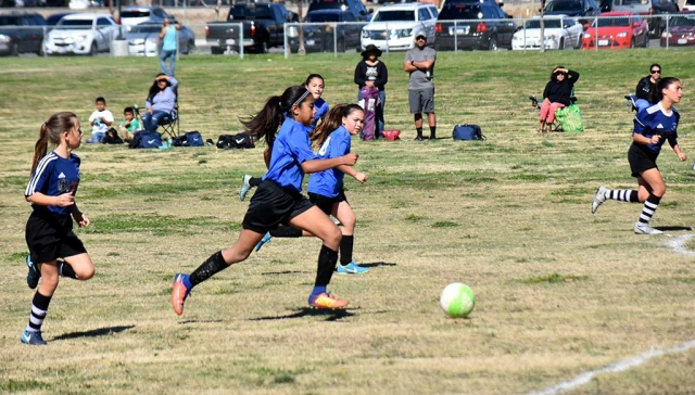 California United's Marlene Gonzales leads the attack versus Oxnard National with teammates Kari Terrazas and Jessica Rodrigues running the wing during this past Saturday's game. Photo Courtesy Martin Hernandez.