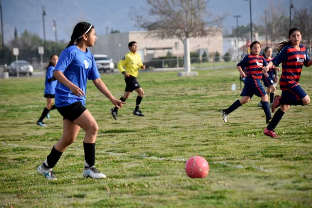 California United's U-12 Fatima Alvarado, mid-fielder, scans the field as she looks to set up the play against USA last weekend. California United defeated USA 8-1. Photo courtesy Evelia Hernandez.