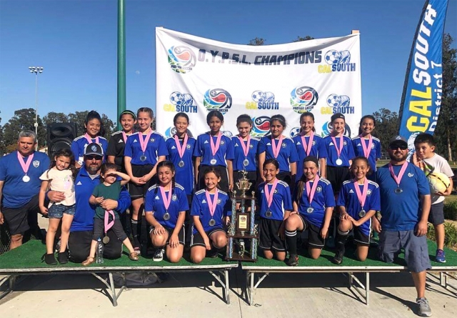 Congratulations to the California United FC 2006 Girls Silver team for taking second place in their division at the Premier Cup 2019 which took place March 16th & 17th in Oxnard. Pictured is the team after their win. Top row: Alexis Piña, Gabriela Martinez, Mikayla McKenzie, Lizbeth Mendez, Jadon Rodriguez, Athena Sanchez, Kim Manriquez, Jessica Rodriguez, Brooke Núñez, Miley Tello. Bottom Row: Coach Cip Martinez, Coach Jr Lomelí, Isabel Hernandez, Jazleen Vaca, Luvia Cabral, Karissa Terrazas, Victoria Piña, Coach Tony Hernandez. Photo courtesy Nancy Vaca.