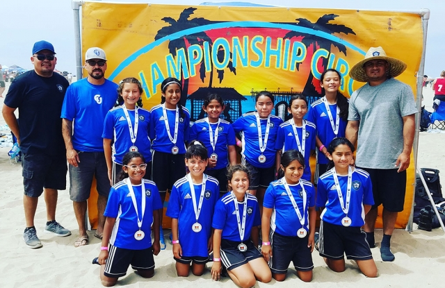"Pictured above is the California United FC 2008 Girls Soccer Team which finished as finalist in the Copa Cabana Beach Soccer Tournament in Huntington Beach this past week. Top row (l-r): Assistant Coach Asiano ""Chano"" Mendez, Assistant Coach John Cabral, Jazleen Vaca, Valerie Rubio, Delila Ramirez, Anel Castillo, Danna Castillo, Lizbeth Mendez, Head Coach David Vaca. Bottom row left to right: Joelle Rodriguez, Fiona Cabral, Leanna Villa, Sara Diaz and Alondra Leon. Not Pictured: Nathalia Orosco. Photo courtesy Nancy Vaca."