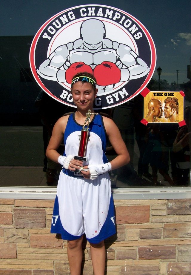 The Fillmore Boxing Club's Demily Amezcua recently competed in San Fernando, CA in the 100 lb. weight class. She was victorious in her debut match winning via decision vs. Kayline Marez of the Young Champions Boxing Club. The bout was three rounds of one and a half minute duration. Amezcua was able to establish a jab that was the difference maker in the first two rounds of the bout and was able to fight off her persistent opponent's attacks in the final round.