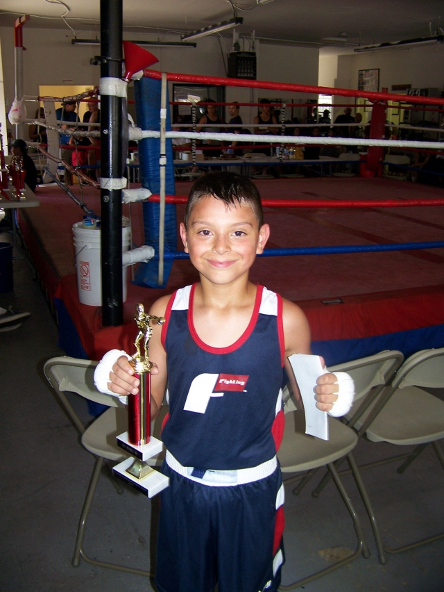 The Fillmore Boxing Club's Diego Amezcua competed this weekend at the Young Champions Boxing Show in San Fernando, CA in the 65 lb. weight class. He was victorious in his match winning via decision vs. Robert Camberos of Tarzana's Outlaws Boxing Club. The bout was three rounds of one minute duration. Amezcua's next contest is scheduled for October 13th in Valencia.