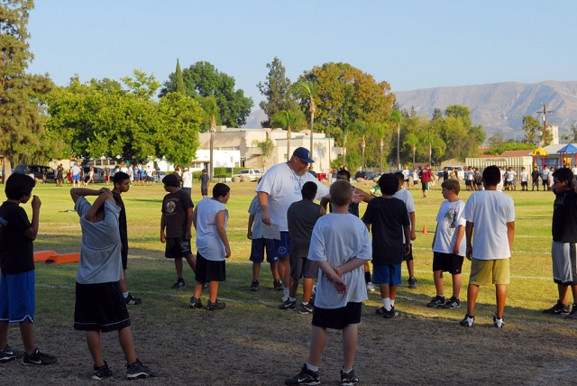 Fillmore Raiders Football started camp last week. Pictured above Joe Woods coach for J2's is explaining a drill to the kids. This year the Raiders have 8 teams, Mighty Mights to J2's.