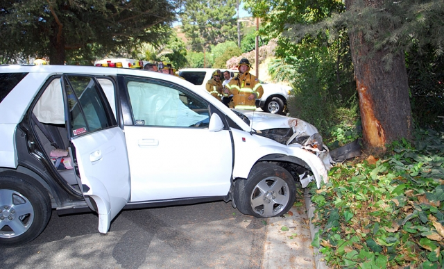 Midday Friday, the driver of this car lost control heading north up Hillside Drive and crashed into a Pine tree. No cause for the accident was available, and no serious personal injuries were reported. The vehicle suffered substantial damage.