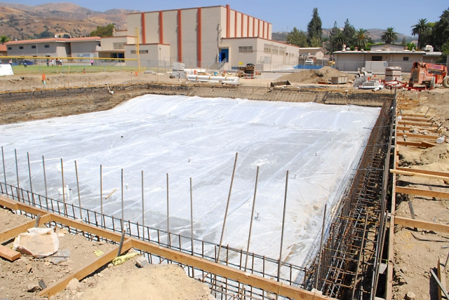 A different photo angle, looking East, of the swimming pool after the floor was poured.