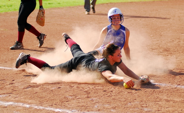 Ashley Grande is safe at third after sliding. Lady Flashes played Santa Paula and beat them 9-5.