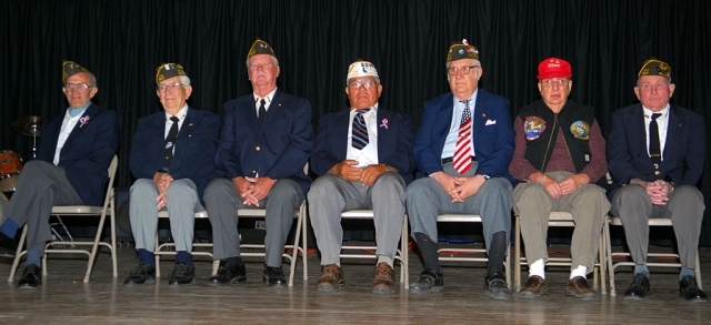 Fillmore's war heroes honored at Middle School's Pride in America Day. From left, Richard Schuck, Bud Untiedt, Victor Westerberg, William Preciado, J. C. Woods, Wendell Tilley, and John Pressey. This year's program was attended by a disciplined and respectful student audience, and especially dedicated to Staff Sergeant Felix Gabriel Chavez, U.S. Army, who is recovering from severe injuries suffered by an improvised explosive device (IED) while fighting in Iraq. A special slide presentation was shown, with a thank you message from Gabriel Chavez.