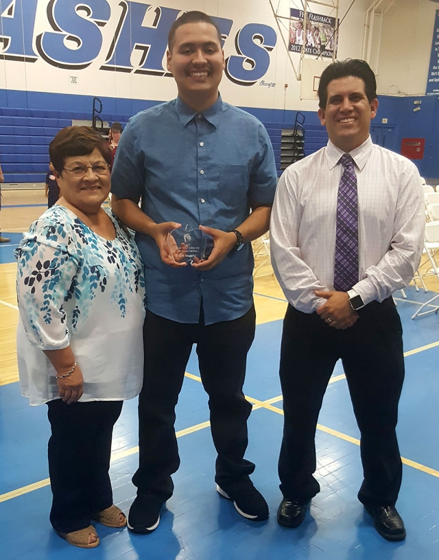 On May 29th, Fillmore High School Senior Erik Magana (center) was presented the Rosie Torres Scholarship for Future Teachers by both Rosie and Michael Torres at the campus awards ceremony. Photo courtesy Ralph Flores.
