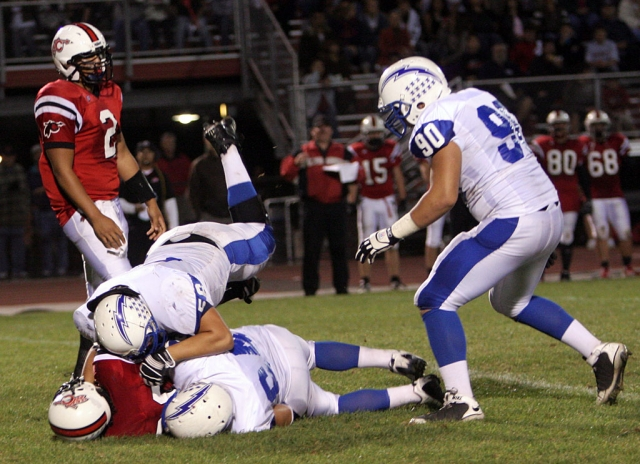 Emilio Gomez #90 helps out with the tackle.